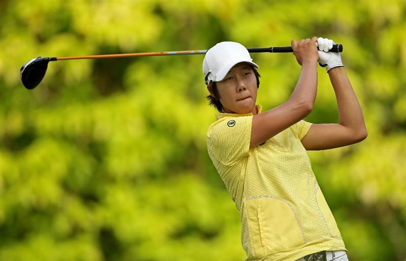 SINGAPORE - FEBRUARY 25:  Song-Hee Kim of South Korea hits her tee-shot on the sixth hole during the first round of the HSBC Women's Champions at the Tanah Merah Country Club on February 25, 2010 in Singapore.  (Photo by Andrew Redington/Getty Images)