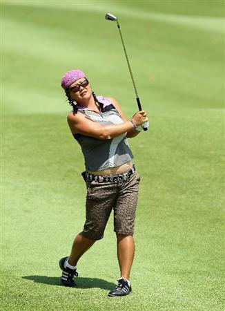 SINGAPORE - FEBRUARY 26:  Christina Kim of the USA hits her second shot on the 6th hole during the second round of the HSBC Women's Champions at Tanah Merah Country Club on February 26, 2010 in Singapore, Singapore.  (Photo by Andy Lyons/Getty Images)