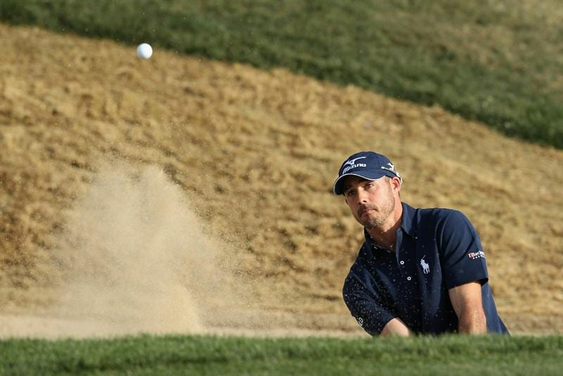 SCOTTSDALE, AZ - FEBRUARY 06:  Jonathan Byrd chips out of the bunker onto the seventh hole green during the final round of the Waste Management Phoenix Open at TPC Scottsdale on February 6, 2011 in Scottsdale, Arizona.  (Photo by Christian Petersen/Getty Images)