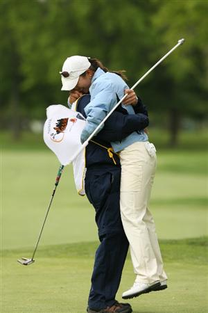 CLIFTON, NJ - MAY 17: Ji Young Oh (R) of South Korea hugs her caddie after holing out on the 18th green to win the Sybase Classic presented by ShopRite at Upper Montclair Country Club May 17, 2009 in Clifton, New Jersey. (Photo by Hunter Martin/Getty Images)