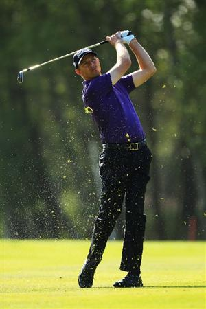 VIRGINIA WATER, ENGLAND - MAY 19:  Soren Hansen of Denmark plays an iron shot during the Pro-Am round prior to the BMW PGA Championship on the West Course at Wentworth on May 19, 2010 in Virginia Water, England.  (Photo by Warren Little/Getty Images)