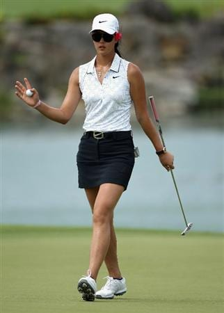 SINGAPORE - FEBRUARY 24:  Michelle Wie of the USA waves to the crowd on the 18th hole during the first round of the HSBC Women's Champions at the Tanah Merah Country Club on February 24, 2011 in Singapore.  (Photo by Andrew Redington/Getty Images)