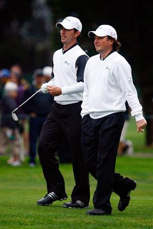 SAN FRANCISCO - OCTOBER 10:  Mike Weir, (L) and Tim Clark of the International Team walk to the fifth green during the Day Three Morning Foursome Matches of The Presidents Cup at Harding Park Golf Course on October 10, 2009 in San Francisco, California.  (Photo by Scott Halleran/Getty Images)