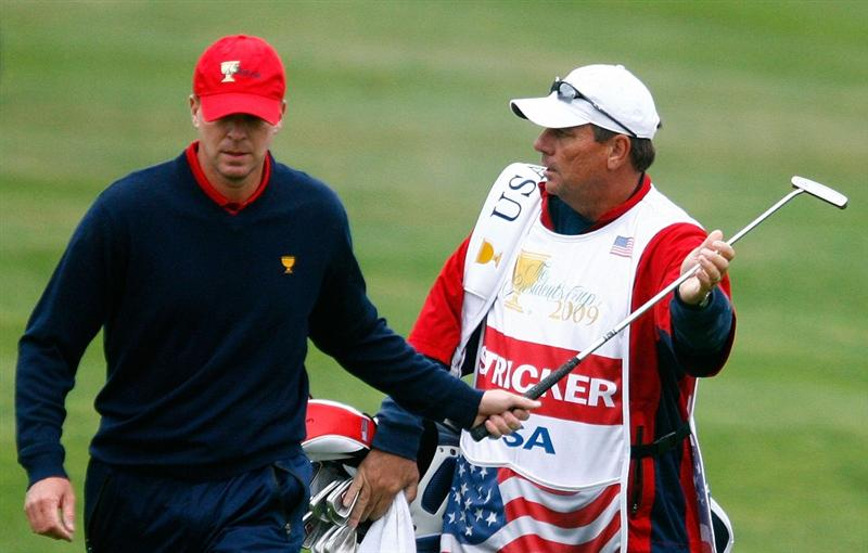 SAN FRANCISCO - OCTOBER 11:  Steve Stricker of the USA Team walks to thye first green as his caddie Jimmy Johnson looks on during the Final Round Singles Matches of The Presidents Cup at Harding Park Golf Course on October 11, 2009 in San Francisco, California.  (Photo by Scott Halleran/Getty Images)