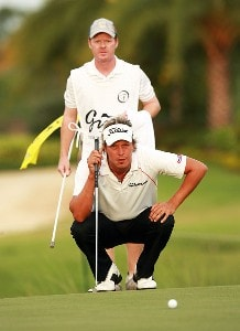 Fredrik Jacobson and his caddie line up a par putt on the 17th green during the final round of the Ginn Sur Mer Classic at Tesoro on October 29, 2007 in Port Saint Lucie, Florida. PGA TOUR - 2007 Ginn sur Mer Classic - Final RoundPhoto by Doug Benc/WireImage.com