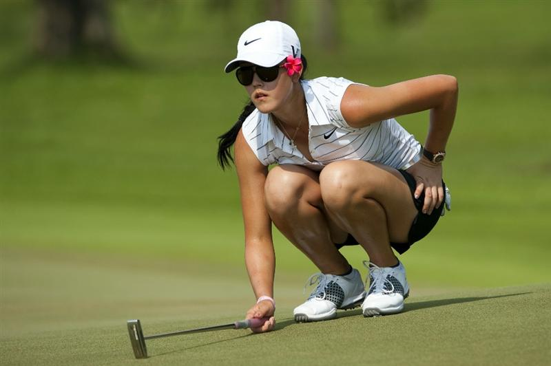 CHON BURI, THAILAND - FEBRUARY 19:  Michelle Wie of USA lines up a putt on the 12th green during day three of the LPGA Thailand at Siam Country Club on February 19, 2011 in Chon Buri, Thailand.  (Photo by Victor Fraile/Getty Images)