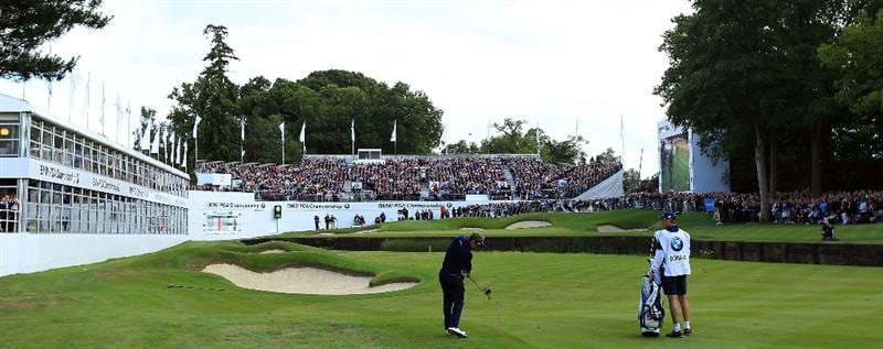 VIRGINIA WATER, ENGLAND - MAY 27:  Luke Donald of England hits his approach to the 18th green during the second round of the BMW PGA Championship at the Wentworth Club on May 27, 2011 in Virginia Water, England.  (Photo by David Cannon/Getty Images)
