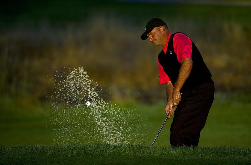 SAN MARTIN, CA - OCTOBER 15:  Rocco Mediate makes a shot out of a bunker on the eleventh hole during the second round of the Frys.com Open at the CordeValle Golf Club on October 15, 2010 in San Martin, California.  (Photo by Robert Laberge/Getty Images)