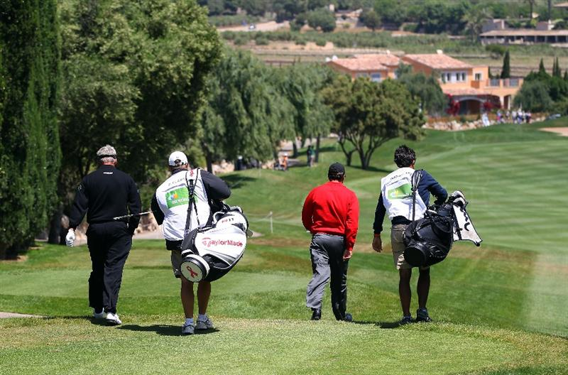 MALLORCA, SPAIN - MAY 14:  Jose Maria Olazabal of Spain and Darren Clarke of Northern Ireland walk down the 1st hole during day four of the Iberdrola Open at Pula Golf Club on May 15, 2011 in Mallorca, Spain.  (Photo by Julian Finney/Getty Images)