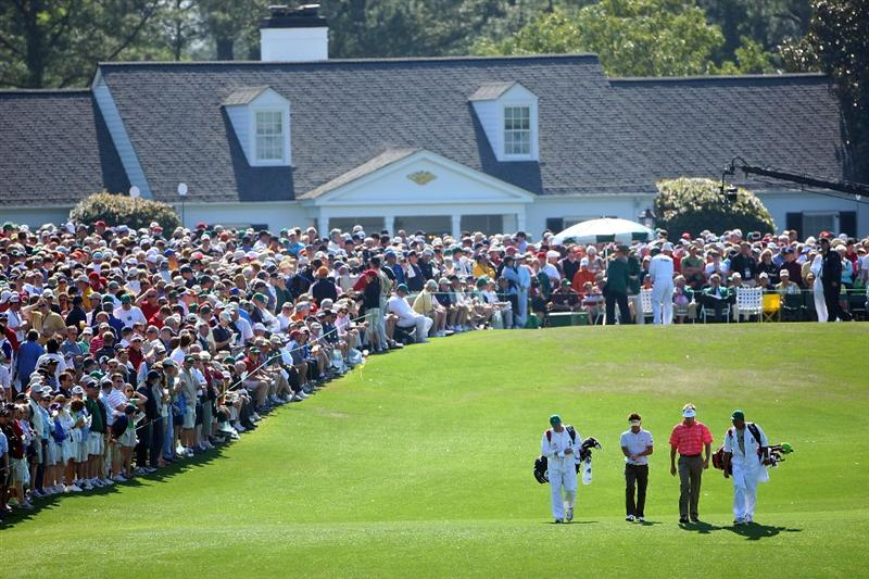 AUGUSTA, GA - APRIL 11:  Ryuji Imada of Japan and Stuart Appleby of Australia walk off the first tee during the third round of the 2009 Masters Tournament at Augusta National Golf Club on April 11, 2009 in Augusta, Georgia.  (Photo by Andrew Redington/Getty Images)