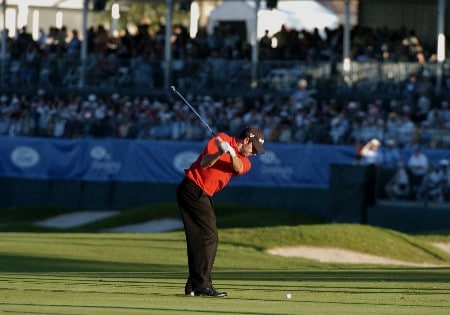 Jose Maria Olazabal hits into the 18th green in the setting sun  during third-round competition March 5, 2005  at the Ford Championship at Doral in Miami.
