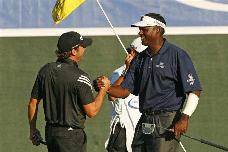 NORTON, MA - SEPTEMBER 1: (L-R) Sergio Garcia of Spain shakes hands with Vijay Singh of Fiji Islands on the 18th hole during the final round Deutsche Bank Championship at TPC Boston on September 1, 2008 in Norton, Massachusetts. (Photo by Hunter Martin/Getty Images)