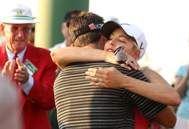 AUGUSTA, GA - APRIL 10:  Charl Schwartzel of South Africa celebrates his two-stroke victory with his wife Rosalind behind the 18th green during the final round of the 2011 Masters Tournament at Augusta National Golf Club on April 10, 2011 in Augusta, Georgia.  (Photo by Andrew Redington/Getty Images)