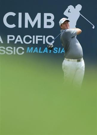 KUALA LUMPUR, MALAYSIA - OCTOBER 28: Marcus Fraser of Australia tees off on the 10th hole  during day one of the CIMB Asia Pacific Classic at The MINES Resort & Golf Club on October 28, 2010 in Kuala Lumpur, Malaysia. (Photo by Stanley Chou/Getty Images)