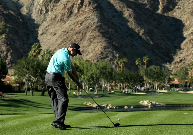 LA QUINTA, CA - JANUARY 23:  Bill Haas hits his tee shot on the 13th hole during the final round of the Bob Hope Classic on the Palmer Private Course at PGA West on January 23, 2011 in La Quinta, California. (Photo by Stephen Dunn/Getty Images)