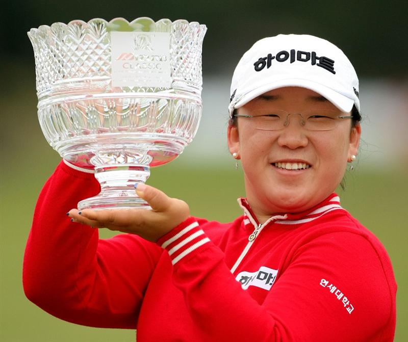 SHIMA, JAPAN - NOVEMBER 09:  Ji-Yai Shin of South Korea poses with the trophy after winning the 2008 Mizuno Classic at Kintetsu Kashikojima Country Club on November 9, 2008 in Shima, Mie, Japan.  (Photo by Koichi Kamoshida/Getty Images)