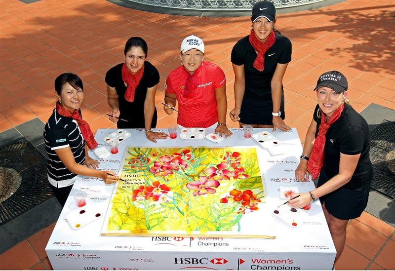 SINGAPORE - FEBRUARY 23:  (L-R) Ai Miyazato of Japan, Lorena Ochoa of Mexico, Jiyai Shin of South Korea, Michelle Wie of the USA and Christie Kerr of the USA pose next to the batik artwork they all contributed to during a photocall at Raffles Hotel prior to the HSBC Women's Champions at the Tanah Merah Country Club  on February 23, 2010 in Singapore.  (Photo by Andrew Redington/Getty Images)