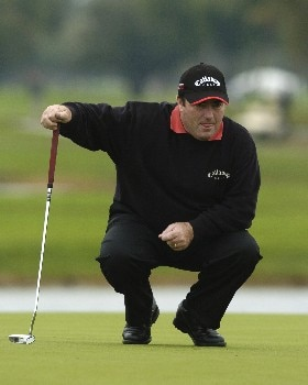 Craig Parry studies a putt on the ninth green  during second-round competition March 4, 2005  at the  2005 Ford Championship at Doral in Miami.   Parry shot a 66 to tie for the lead at eight under par.