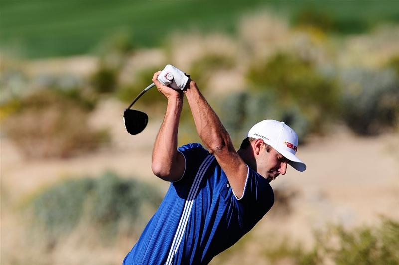 MARANA, AZ - FEBRUARY 16:  Dustin Johnson tees off during the second practice round prior to the start of the Accenture Match Play Championship at the Ritz-Carlton Golf Club on February 16, 2010 in Marana, Arizona.  (Photo by Stuart Franklin/Getty Images)