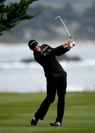 PEBBLE BEACH, CA - FEBRUARY 12: Dustin Johnson hits his second shot on the 18th hole during the first round of the the AT&T Pebble Beach National Pro-Am on Pebble Beach Golf Links on February 12, 2009 in Pebble Beach, California. (Photo by Stephen Dunn/Getty Images)