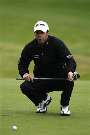 VIRGINIA WATER, ENGLAND - MAY 26:  Bradley Dredge of Wales lines up a putt during the first round of the BMW PGA Championship at Wentworth Club on May 26, 2011 in Virginia Water, England.  (Photo by Warren Little/Getty Images)
