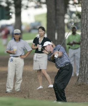 John Huston plays from the pine straw on the first hole during the third round of the 2005 Chrysler Classic of Greensboro at Forest Oaks Country Club in Greensboro, North Carolina on October 1, 2005.Photo by Michael Cohen/WireImage.com
