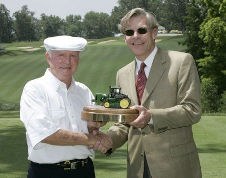 Deane Beman, left, is presented with a plaque from Bill Lane, CEO of the John Deere Company, following the Drive for a Billion ceremony at the 2005 John Deere Championship held at the TPC at Deere Run in Silvis, Illinois on Wednesday, July 6, 2005.  Beman won the event in 1971 and 1972.Photo by Sam Greenwood/WireImage.com