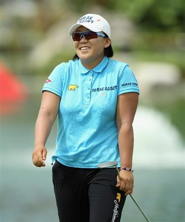 SINGAPORE - FEBRUARY 24:  Jiyai Shin of South Korea smiles on the 18th hole during the first round of the HSBC Women's Champions at the Tanah Merah Country Club on February 24, 2011 in Singapore.  (Photo by Andrew Redington/Getty Images)