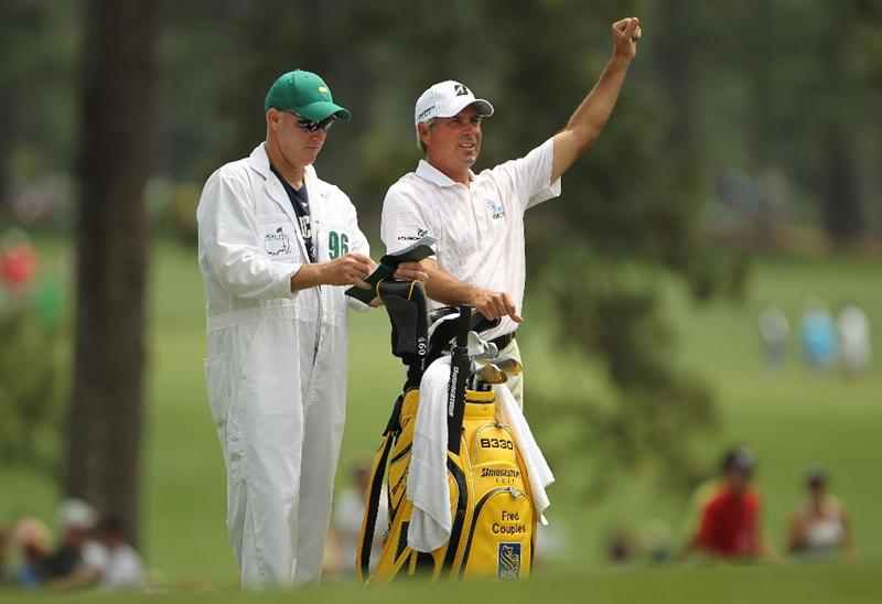 AUGUSTA, GA - APRIL 09:  Fred Couples (R) waits with his caddie Joe LaCava on the first hole during the third round of the 2011 Masters Tournament at Augusta National Golf Club on April 9, 2011 in Augusta, Georgia.  (Photo by Jamie Squire/Getty Images)