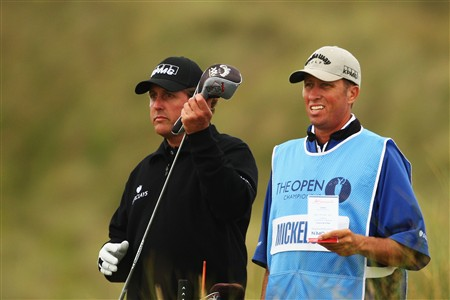 SOUTHPORT, UNITED KINGDOM - JULY 15:  Phil Mickelson of USA pulls a club as his caddie Jim Mackay looks on during the second practice round of the 137th Open Championship on July 15, 2008 at Royal Birkdale Golf Club, Southport, England.  (Photo by Richard Heathcote/Getty Images)