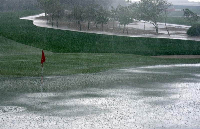 ABU DHABI, UNITED ARAB EMIRATES - JANUARY 15:  Hail stones cover the 17th green as play is halted during the first round the Abu Dhabi Golf Championship at the Abu Dhabi Golf Club on January 15, 2009 in Abu Dhabi, United Arab Emirates.  (Photo by Ross Kinnaird/Getty Images)