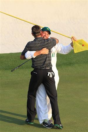 AUGUSTA, GA - APRIL 10:  Charl Schwartzel of South Africa celebrates his two-stroke victory with his caddie Greg Hearmon on the 18th green during the final round of the 2011 Masters Tournament at Augusta National Golf Club on April 10, 2011 in Augusta, Georgia.  (Photo by David Cannon/Getty Images)