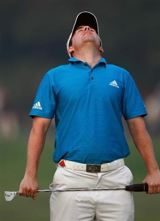 SHANGHAI, CHINA - NOVEMBER 07:  Richie Ramsay of Scotland reacts after a missed putt on the 17th green during the final round of the WGC- HSBC Champions at Sheshan International Golf Club on November 7, 2010 in Shanghai, China.  (Photo by Andrew Redington/Getty Images)