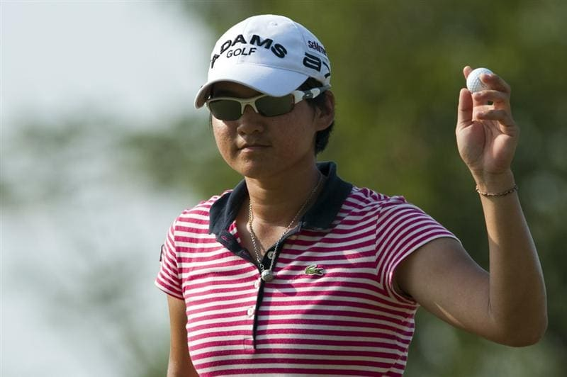 CHON BURI, THAILAND - FEBRUARY 20:  Yani Tseng of Taiwan acknowledges to the crowd on the 13th green during day four of the LPGA Thailand at Siam Country Club on February 20, 2011 in Chon Buri, Thailand.  (Photo by Victor Fraile/Getty Images)
