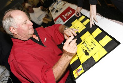 Tom Jenkins signs the tournament flags after being declared the winner of the SAS Championship Sunday, October 8, 2006, at Prestonwood Country Club in Cary, North Carolina.  The final round was canceled due to weather conditions. Champions Tour - 2006 SAS Championship - Final RoundPhoto by Kevin C.  Cox/WireImage.com