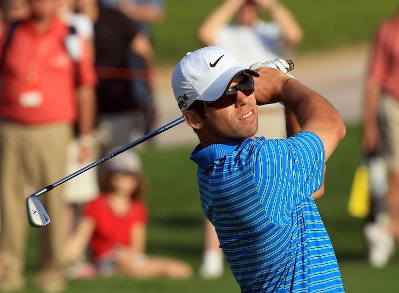 ABU DHABI, UNITED ARAB EMIRATES - JANUARY 22:  Paul Casey of England watches his second shot at the par 4, 16th hole during the second round of The Abu Dhabi Golf Championship at Abu Dhabi Golf Club on January 22, 2010 in Abu Dhabi, United Arab Emirates.  (Photo by David Cannon/Getty Images)