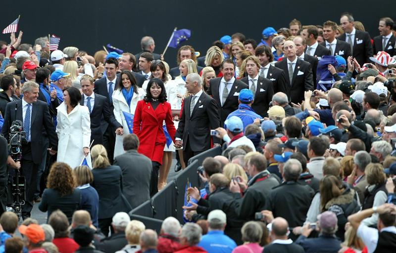 NEWPORT, WALES - SEPTEMBER 30:  Team Captains Corey Pavin (R) of the USA and Colin Montgomerie of Europe lead out the players and their wives and girlfriends during the Opening Ceremony prior to the 2010 Ryder Cup at the Celtic Manor Resort on September 30, 2010 in Newport, Wales.  (Photo by Jamie Squire/Getty Images)