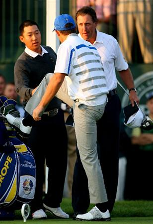 LOUISVILLE, KY - SEPTEMBER 19:  Anthony Kim and Phil Mickelson of the USA team shake hands with Padraig Harrington of the European team on the first tee during the morning foursomes on day one of the 2008 Ryder Cup at Valhalla Golf Club on September 19, 2008 in Louisville, Kentucky.  (Photo by Andrew Redington/Getty Images)