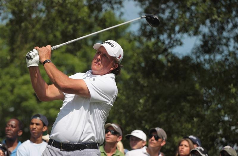 CHARLOTTE, NC - MAY 07:  Phil Mickelson  hits his tee shot on the fourth hole during the third round of the Wells Fargo Championship at the Quail Hollow Club on May 7, 2011 in Charlotte, North Carolina.  (Photo by Scott Halleran/Getty Images)