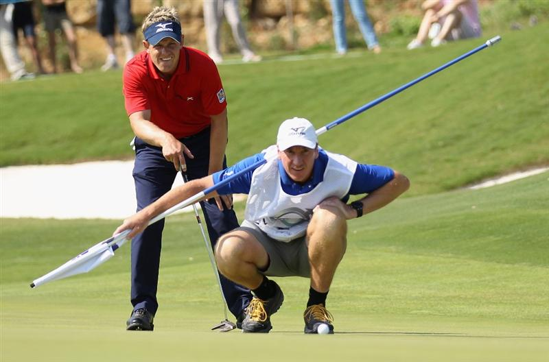 CASARES, SPAIN - MAY 22:  Luke Donald of England lines up a putt on the 14th green during the final of the Volvo World Match Play Championship at Finca Cortesin on May 22, 2011 in Casares, Spain.  (Photo by Warren Little/Getty Images)