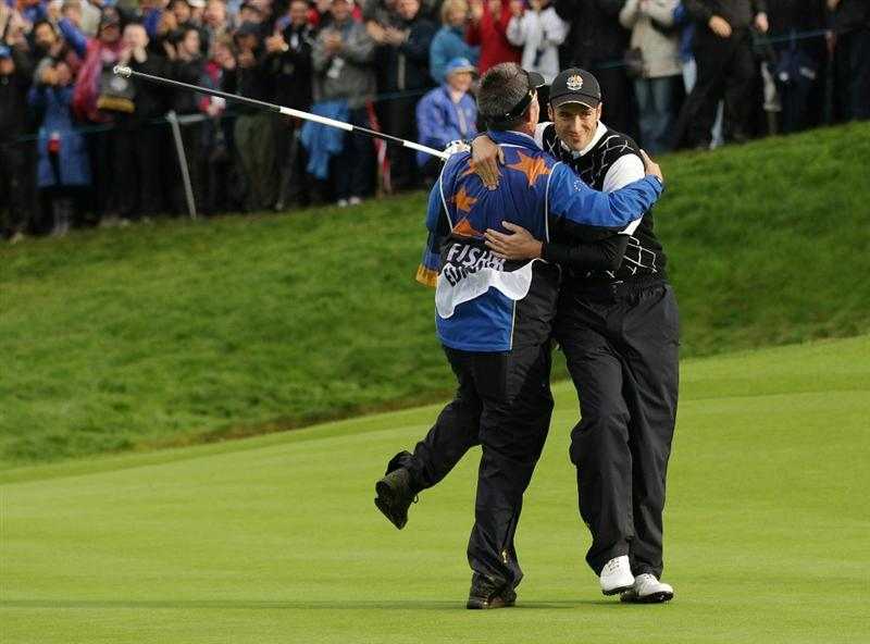 NEWPORT, WALES - OCTOBER 03:  Ross Fisher of Europe celebrates on the 17th green with his caddie Phil Morbey after winning his match during the  Fourball & Foursome Matches during the 2010 Ryder Cup at the Celtic Manor Resort on October 3, 2010 in Newport, Wales. (Photo by Andrew Redington/Getty Images)