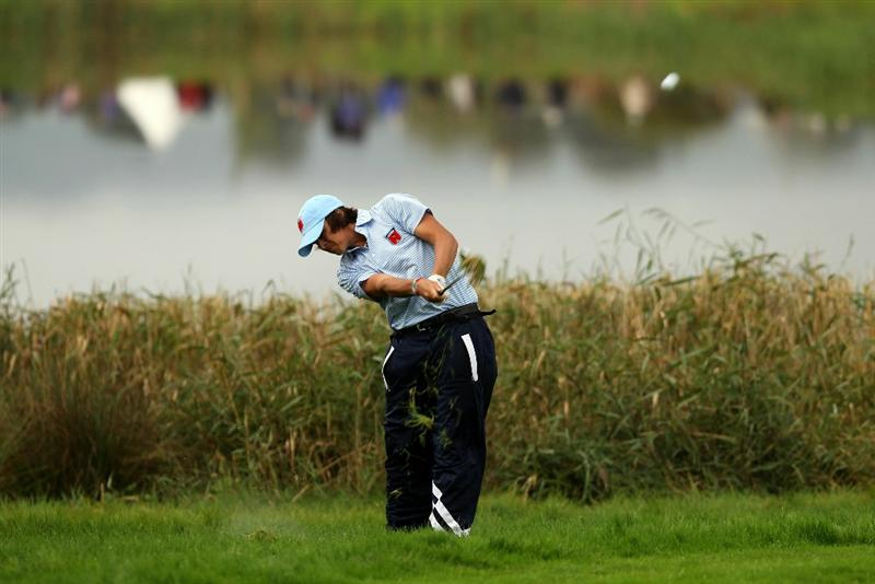 NEWPORT, WALES - OCTOBER 03:  Rickie Fowler of the USA hits from the rough during the Fourball & Foursome Matches during the 2010 Ryder Cup at the Celtic Manor Resort on October 3, 2010 in Newport, Wales.  (Photo by Ross Kinnaird/Getty Images)