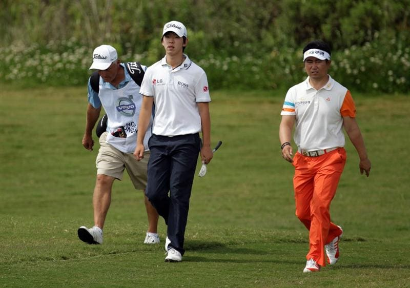 CASARES, SPAIN - MAY 20:  Seung-yul Noh of Korea and YE Yang of Korea during the group stages of the Volvo World Match Play Championship at Finca Cortesin on May 20, 2011 in Casares, Spain.  (Photo by Ross Kinnaird/Getty Images)