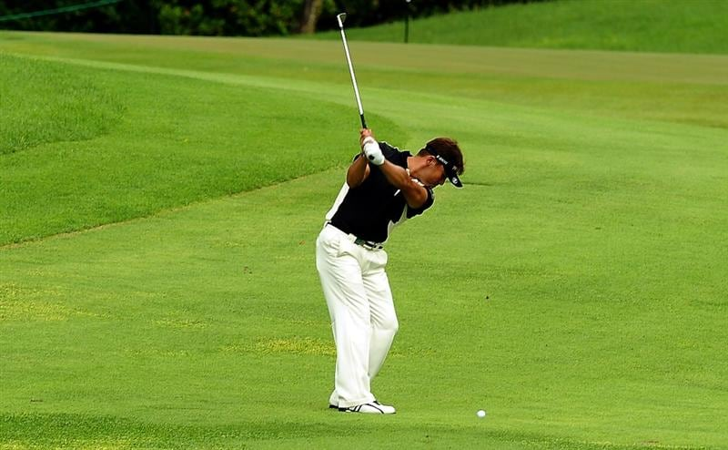 SINGAPORE, NOVEMBER 11 : Shigeki Maruyama of Japan plays an approaching shot on the 12th hole during the First Round of the Barclays Singapore Open held at the Sentosa Golf Club on November 11, 2010 Singapore. ( Photo by : Getty Images/ Stanley Chou )