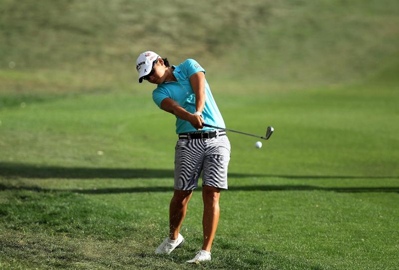 RANCHO MIRAGE, CA - APRIL 02:  Yani Tseng of Taiwan plays her second shot on the 18th hole during the third round of the 2011 Kraft Nabisco Championship on the Dinah Shore Championship Course at the Mission Hills Country Club on April 2, 2011 in Rancho Mirage, California.  (Photo by David Cannon/Getty Images)