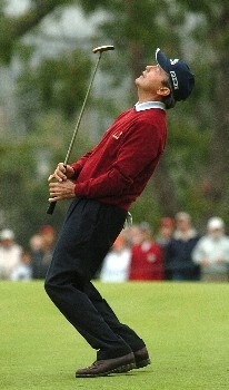 Mark McNulty reacts after a missed birdie putt on the 18th green which would have forced a playoff with eventual winner Des Smyth in the final round of the Champions' Tour 2005 SBC Classic at  the Valencia Country Club in Valencia, California March 13, 2005.