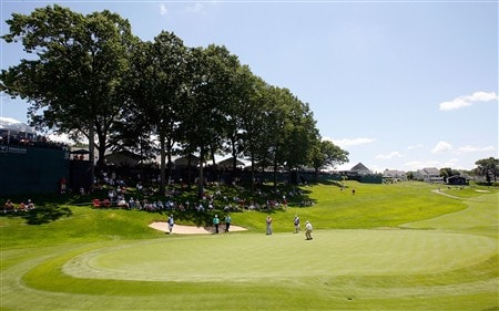 CROMWELL, CT - JUNE 19:  A group of golfers play on the 19th green during the first round of the Travelers Championship held at TPC River Highlands on June  19, 2008 in Cromwell, Connecticut. (Photo by Jim Rogash/Getty Images)