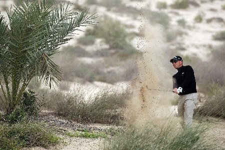 DUBAI, UNITED ARAB EMIRATES - FEBRUARY 01:  Niclas Fasth of Sweden plays his second shot at the 8th hole during the second round of the Dubai Desert Classic, on the Majilis Course at the Emirates Golf Club, on February 1, 2008 in Dubai, United Arab Emirates.  (Photo by David Cannon/Getty Images)