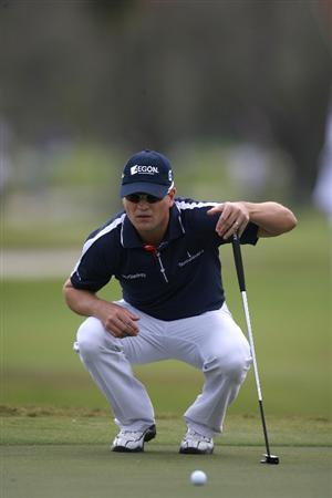 DORAL, FL - MARCH 11:  Zack Johnson lines up a putt on the 11th hole during round one of the 2010 WGC-CA Championship at the TPC Blue Monster at Doral on March 11, 2010 in Doral, Florida.  (Photo by Marc Serota/Getty Images)