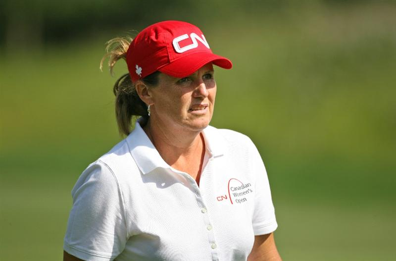 CALGARY, AB - SEPTEMBER 03: Lorie Kane walks to the ninth green during the first round of the Canadian Women's Open at Priddis Greens Golf & Country Club on September 3, 2009 in Calgary, Alberta, Canada. (Photo by Hunter Martin/Getty Images)